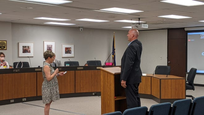 Aaron Peck, right is sworn in as Salina City Commissioner, by City Clerk JoVonna Rutherford, left. Peck is filling the vacancy on the commission left by Rod Franz's resignation in April.