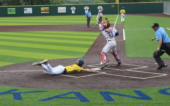 Lane West slides into home plate to score the second run for the Stephenville Yellow Jackets on Saturday, May 22nd at Weatherford High School.