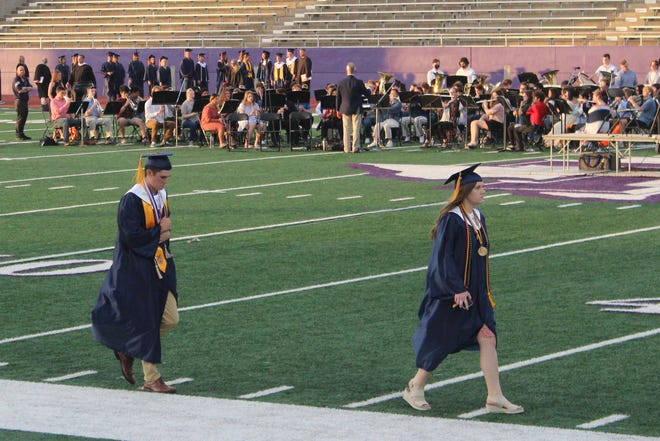 Salutatorian Kyle Styron, left, and valedictorian Madison Nation lead the graduates of the Stephenville High School Class of 2021 onto the field for Friday's commencement at Memorial Stadium.