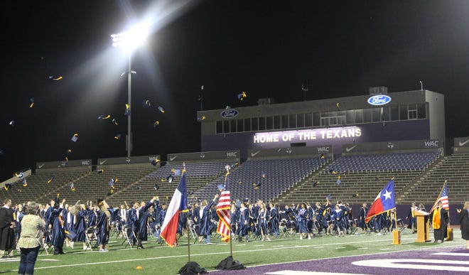 The Stephenville High School Class of 2021 tosses their mortarboards in the air following commencement exercises on Friday evening at Tarleton State University's Memorial Stadium.