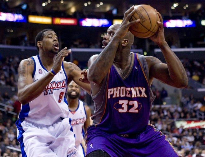 Phoenix Suns center Shaquille O'Neal (32) controls the ball against the Los Angeles Clippers' DeAndre Jordan (9) during an NBA game in Los Angeles on Feb. 18, 2009.