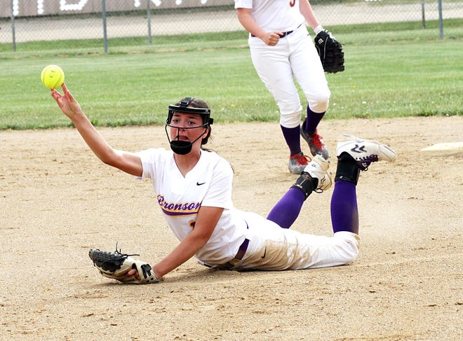 Haylie Wilson of Bronson fires over to first base for an out after making a tough play on a ball Saturday.