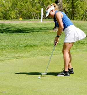 Aberdeen Central's Danielle Podoll putts on No. 8 during the Watertown Girls Golf Invitational on Monday at the Prairie Winds Golf Club in Watertown.