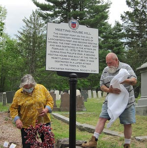Mary and Alan Zoll unveil the sign they recently fabricated for the Lancaster Historical Society. The unveiling in Middle Cemetery took place on Sunday, May 23, at the Freedom' Way Hidden Treasures event.