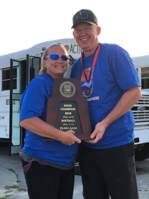 Jack Britt softball coaches Sebrina Wilson and Joe Myrtle hold the 2018 state 4-A softball championship trophy after the Bucs won the best-of-three finals series against South Caldwell. Britt is the only Cumberland County program ever to claim a state title in fastpitch softball.