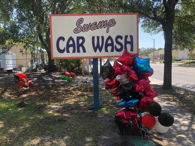 """Balloons are left out in memory of Bobby """"Chedda Bob"""" Bernard Hopkins, Jr., a Gainesville man shot May 24 at the Swamp Car Wash, 912 E. University Ave. Hopkins died later that day from his injuries, according to the Gainesville Police Department."""