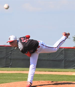 Hiland's Casey Lowe pitched the Hawks to a Division IV District semifinal baseball win over Shenandoah. Here, Lowe is seen firing no-hitter in a Sectional final.