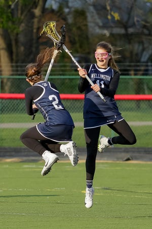 Jessie Seitz (left) and Lilliana Adkinson are expected to be two of the top returnees for the Wellington girls lacrosse squad.