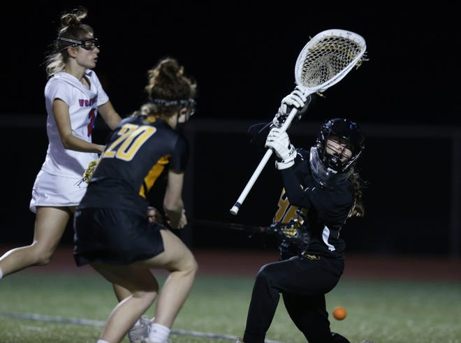 Upper Arlington junior Elizabeth Goth (right) has split time in goal with senior Kate Mason. The Golden Bears were 20-0 before playing Dublin Coffman in the Division I, Region 3 final May 28.