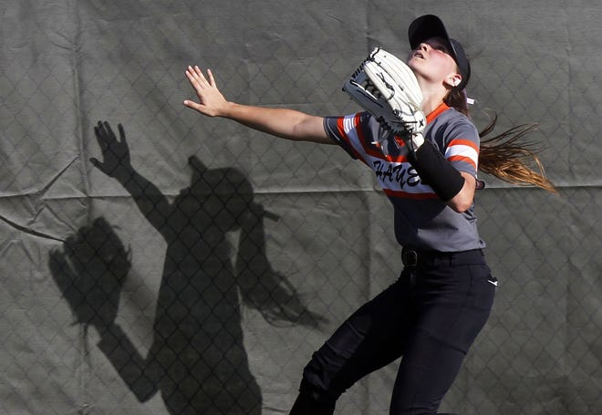 Delaware Hayes' Addy Tope reaches for the fence but runs out of room on a Mount Vernon home run during a Division I district final May 19. The Pacers lost 14-2 in six innings to finish 19-4-1 overall. They won the OCC-Capital title at 13-0.