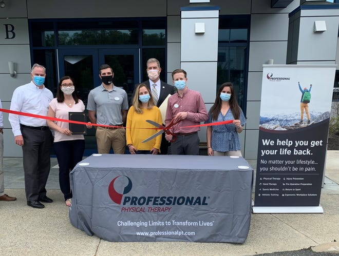 Pictured, from left: Peter Corrigan, former chairman of the Amesbury Chamber of Commerce and vice president with Shaheen Bros; Amesbury Mayor Kassandra Gove; Zach Martin, physical therapist with Professional Physical Therapy; Cammie Bliss, patient care coordinator with Professional Physical Therapy; State Rep. James Kelcourse; Dave McGinty, clinical director with Professional Physical Therapy; Mackenzie Snow, physical therapist with Professional Physical Therapy.