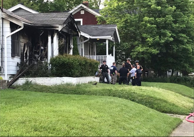 Hamilton Sheriff Charmane McGuffey said the suspect in the fatal shooting of a Sycamore Township woman, who is now in custody, drove a carjacked van to his residence on Home Avenue, and set the house on fire.