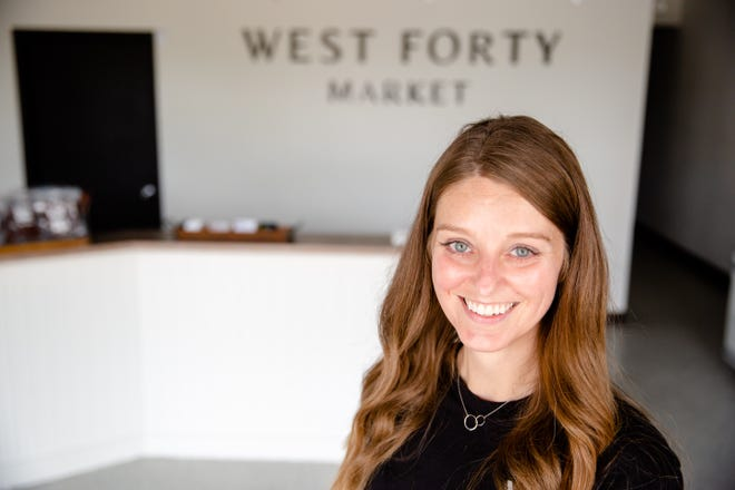 Teresa Davis, owner of the new West Forty Market location in Ankeny, stands for a photo in her store Monday, May 24, 2021.