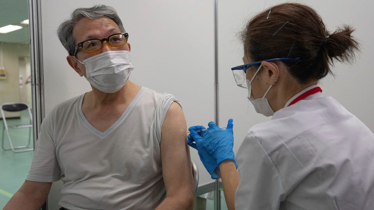 Japan opens mass vaccination centers 2 months before Games 2