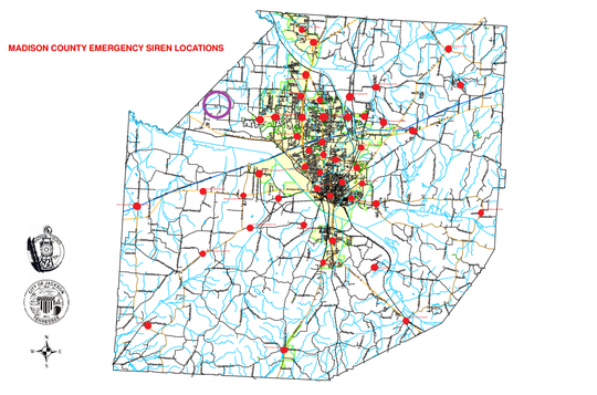 A map of the Madison County tornado sirens, marked in red. The purple circle on the north-western edge of the county marks the general area the new siren will be located.