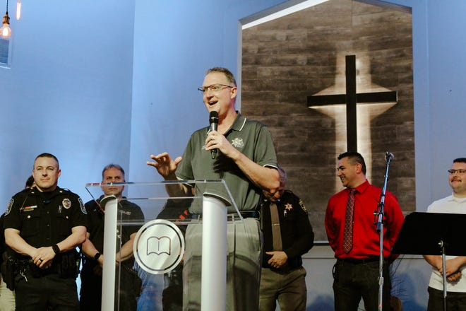 Livingston County Sheriff Mike Murphy thanks community members during a church service May 24 at Bible Baptist Church, 2258 E. Highland Road in Howell.