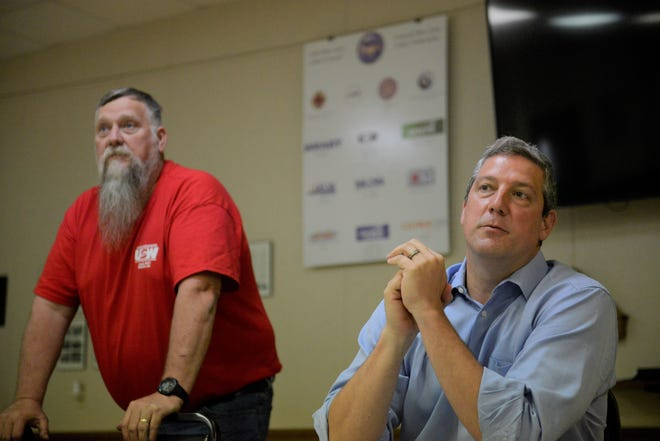 U.S. Senate candidate Tim Ryan, right, visits the steelworkers union hall in Shelby in May.
