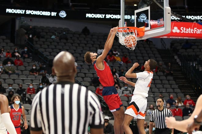 John Paul II junior center Cameron Corhen, pictured during a game against Rockwall-Heath in Dec. 2020, received a scholarship offer from Memphis last week.