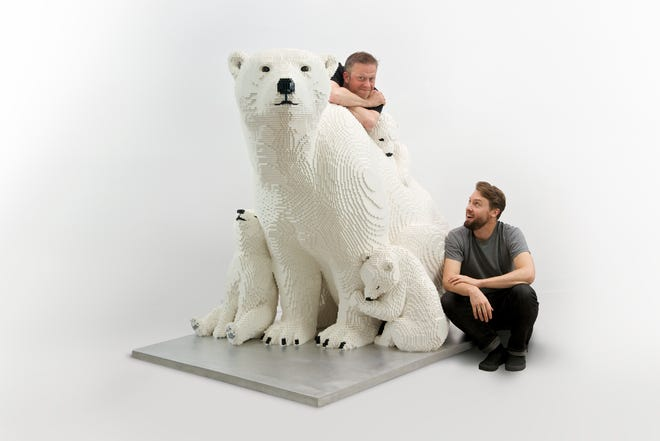 A mother polar bear with its cubs is one of the Lego sculptures in Sean Kenney's Animal Super Powers Made with Lego Bricks exhibit on display at the Milwaukee County Zoo.