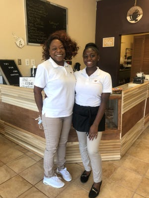 Owner Tolesha Hardmon, left, and her daughter, Skye, opened The Coffee House in downtown Montgomery.