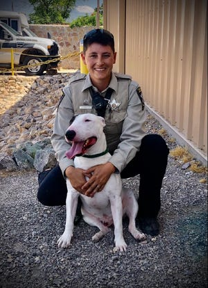Doña Ana County Animal Control Officer Gwyneth Kingsley and Gucci spend time together on May 22, 2021 at the County's Courtheld Animal Facility.