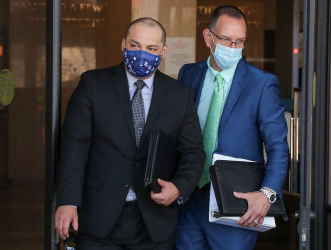Alfredo Luna Jr., left, leaves the Larson Justice Center with his lawyer Michael Selyem, May 24, 2021.  Luna was arrested as part of an FBI Joint Terrorism Task Force investigation into domestic extremism.