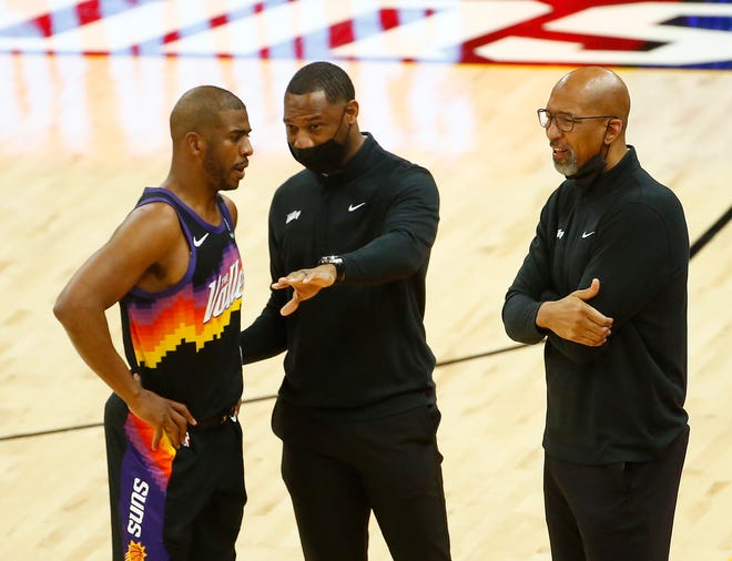 May 23, 2021; Phoenix, Arizona, USA; Suns' Chris Paul (L) talks with assistant coach Willie Green during the first quarter of game 1 against the Lakers at Phoenix Rising Stadium. Patrick Breen-Arizona Republic