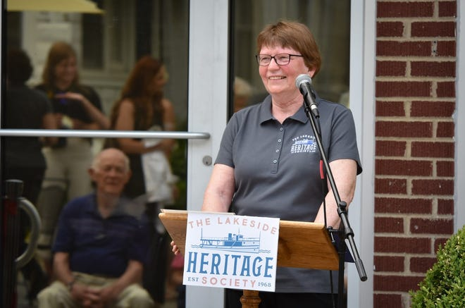 Lakeside Heritage Society President Kathy Venema addresses the crowd during the opening of the new LHS Archives building.