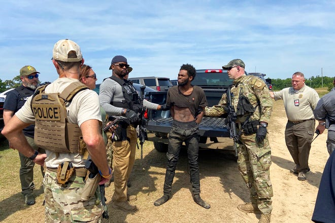 In this photo provided by the Chester County Sheriff's Office, Tyler Terry is arrested in South Carolina on Monday, May 24, 2021. A weeklong manhunt for Terry, a suspect wanted in the killings of four people, ended without another shot fired as hundreds of officers surrounded him, authorities said. (Chester County Sheriff's Office via AP)