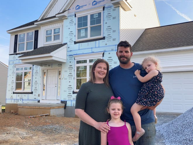 Kendall and Chris Gardepe gave up the battle with other buyers for an existing home because it was a roller coaster. Here, they're with daughters Adisyn (front) and Grace. They're nearly finished home is in an Annville neighborhood in Lebanon County. While their closing date was delayed because of material shortages, they're pretty close to the target date.