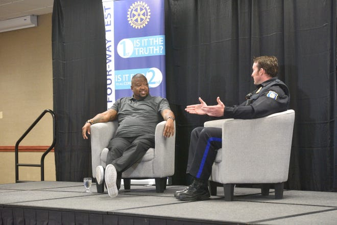 Vaney Hariri, left, and Jon Thum talk a year after their initial conversation about race and policing on Monday at the Sioux Falls Downtown Rotary meeting.