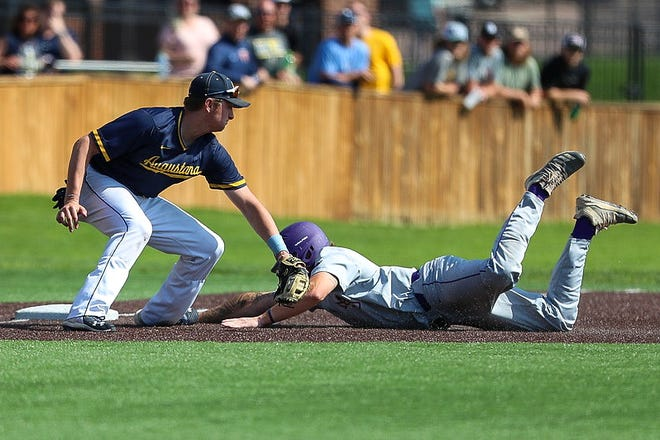 Augustana's Jordan Barth lays down a tag during the NSIC baseball tournament last Friday at Ronken Field.