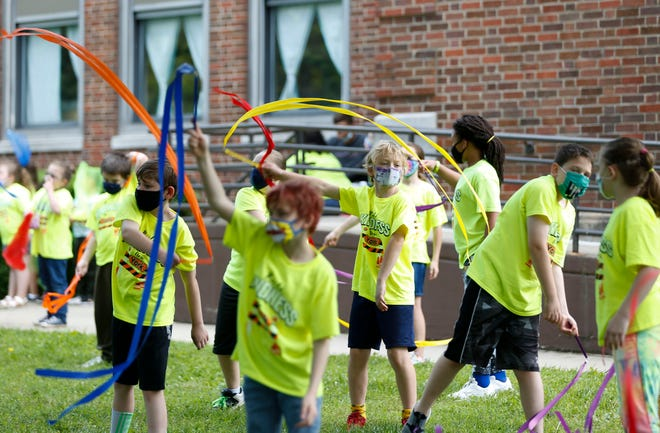 Students at York Elementary School participate in the schools final community event on Monday, May 24, 2021. The 110-year-old school will be demolished soon to make way for a new building.