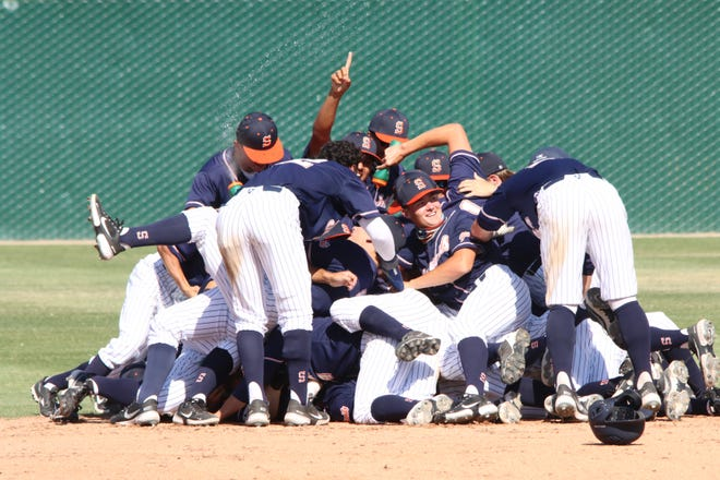 The College of the Sequoias baseball team celebrates a victory.