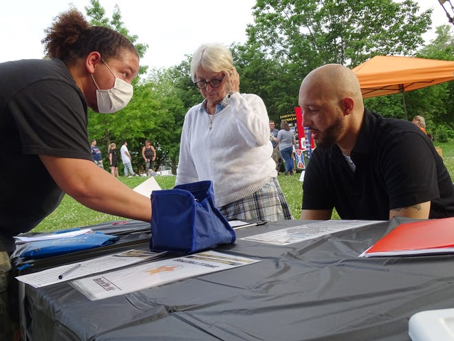 """Organizer Kyle Johnson meets with judges Vicky French and Andre Crockwell ahead of the """"Who Will Rule the Mic?"""" performing arts competition on Sunday, May 23, 2021 at Zane's Landing Park. They chose three finalists from 14 acts. Thefinalists will compete for the title in June."""