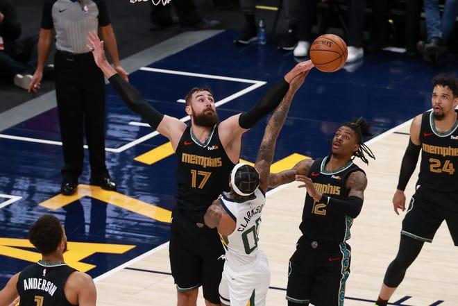 Memphis Grizzlies center Jonas Valanciunas blocks the shot of Utah Jazz guard Jordan Clarkson during the second quarter at Vivint Arena.