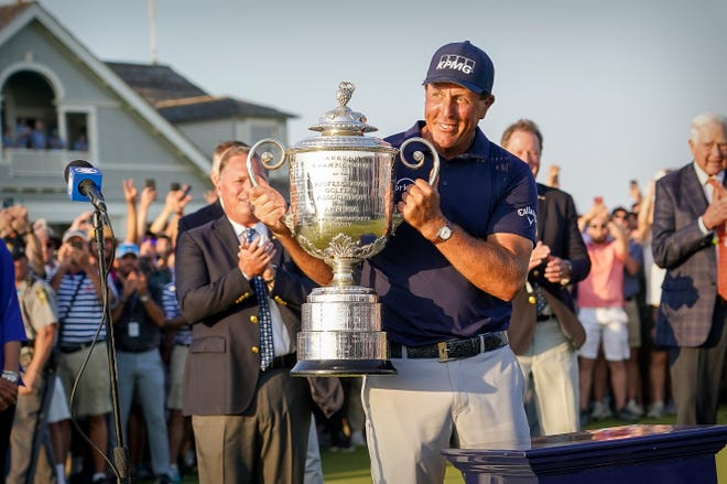 Phil Mickelson raises the Wanamaker Trophy after winning the PGA Championship.