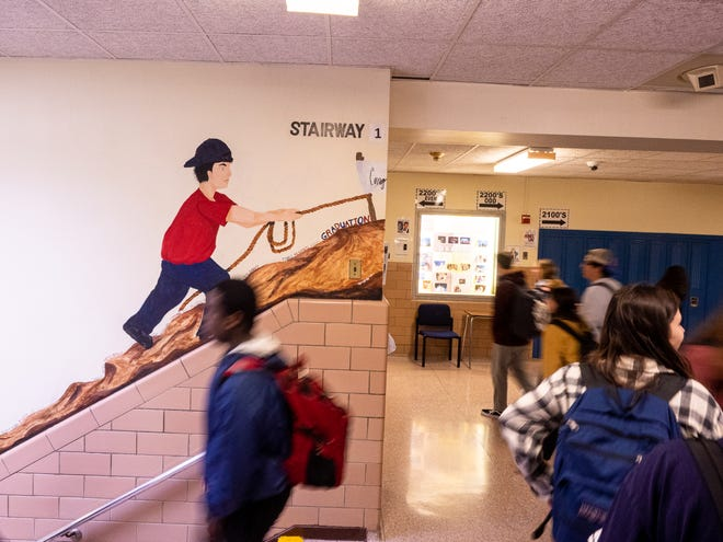 Students walk the hallways in between periods at South Side High School. Experts expect many students to have mental health issues that need addressing as the pandemic recedes, but few communities have enough social workers and psychologists to adequately respond to students' needs.