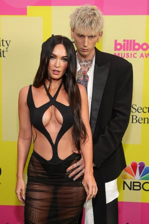 Machine Gun Kelly and Megan Fox Pose Backstage for the 2021 Billboard Music Awards, airing May 23, 2021 at the Microsoft Theater in Los Angeles, California.