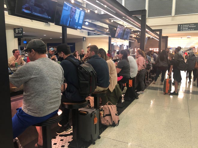 Airport bars are filling up again as travel demand rebounds. Bars and restaurants that were spacing out seating are no longer doing so at many airports, including Chicago's Midway International Airport, but seats are still hard to find.