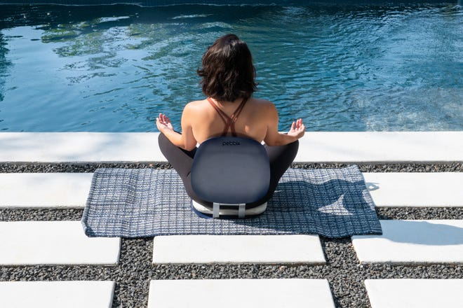 Pebbl provides good back support anywhere someone wants to meditate. The chair was created by sisters Melissa Nathan and Paige Davis, who live in Austin.