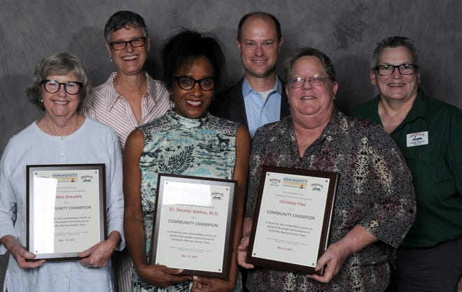 The Smithville Chamber of Commerce awarded its Community Champion Awards to Debbie Bresette (front row, left), Dr. Desmar Walkes (front row, center), Christine Files (front row, right)  and Robert Tamble (not pictured). Sen. Sarah Eckhardt (back row, left), Rep. John Cyrier (back row, center) and chamber Chair Linda Bauer (back row, right) presented the awards.