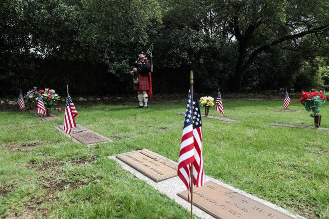 A bagpipe plays during closing of the Memorial Day Remembrance service by Oak Hill VFW Post 4443 at Cook-Walden cemetery in Austin on May 25, 2020. [LOLA GOMEZ / AMERICAN-STATESMAN]