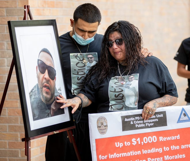 Chris Martinez Jr., the son of homicide victim Christopher Ray Martinez, consoles his aunt, Christina Martinez, on May 25 at Austin Police Department headquarters, where they asked for help from the public to find the suspect, Christian Perez Morales. Austin has seen 48 homicides so far this year.