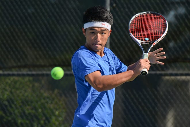 Victor Huang hits a backhand shot during practice  at Oconee County High School. (Julian Alexander for the Athens Banner-Herald)