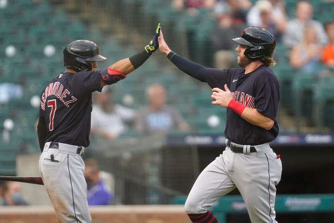 Cleveland's Owen Miller, right, celebrates scoring with Cesar Hernandez (7) during a game earlier this season. With Hernandez traded to the Chicago White Sox, Miller is getting more opportunities to prove himself. [Paul Sancya/Associated Press]