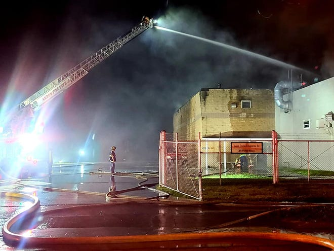 Akron firefighters battle a fire at an adhesives company in South Akron.