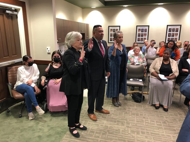 From Left: Anette Carlisle, John Betancourt and Peggy Carter Thomas take their respective oaths of office after they were elected in May to the three open seats on the Amarillo College Board of Regents.