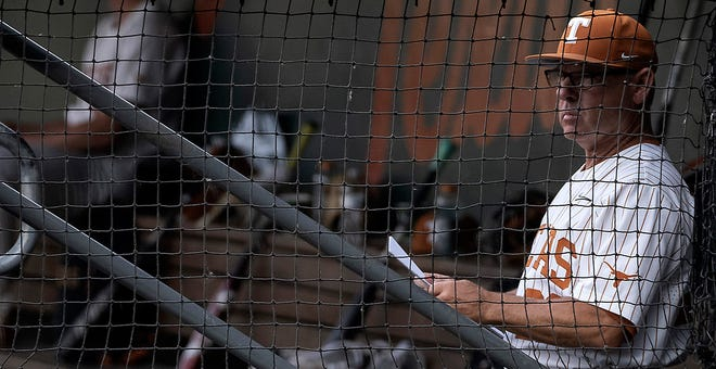 Texas baseball coach David Pierce watches from the dugout during a 14-3 win over West Virginia on May 21. Pierce, this year's Big 12 coach of the year, plans to start staff ace Ty Madden on five days' rest in the Longhorns' opening game of the Big 12 Tournament.
