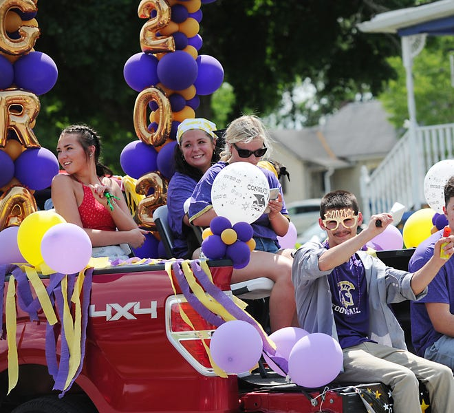 Graduates and their families participate during a parade after Sebring McKinley High School celebrated the Class of 2021's commencement Sunday.